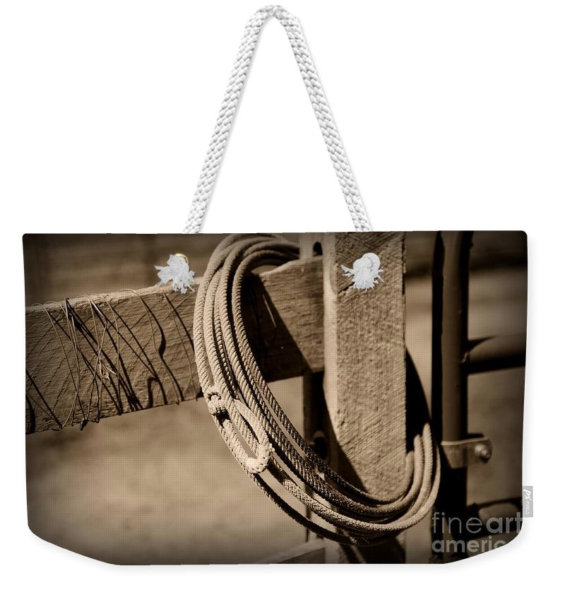 Paul Ward Weekender Tote Bag featuring the photograph Lasso On Fence Post Rustic by Paul Ward