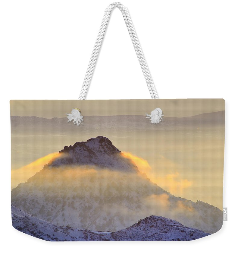 Sunset Weekender Tote Bag featuring the photograph Last Sunset Light In The Clouds by Guido Montanes Castillo