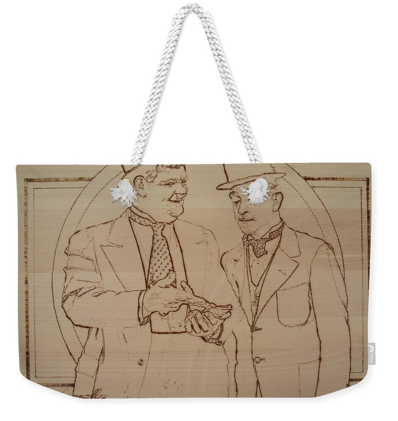 Pyrography Weekender Tote Bag featuring the pyrography Laurel And Hardy - Thicker Than Water by Sean Connolly