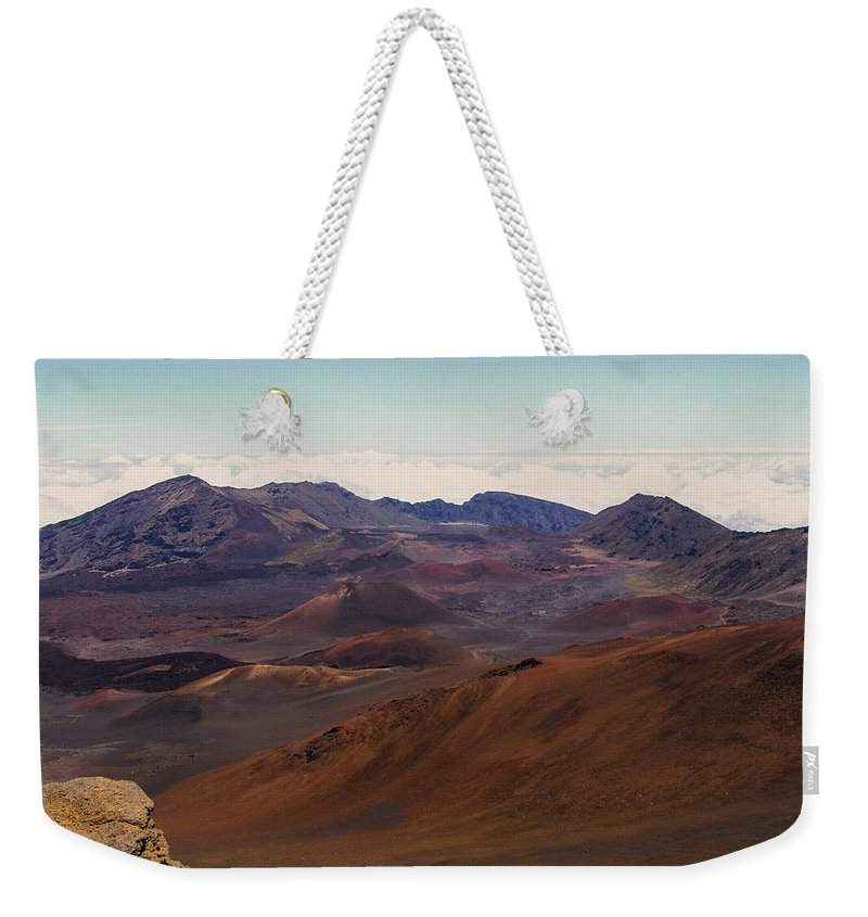 Maui Weekender Tote Bag featuring the photograph Lava Color by Eric Swan