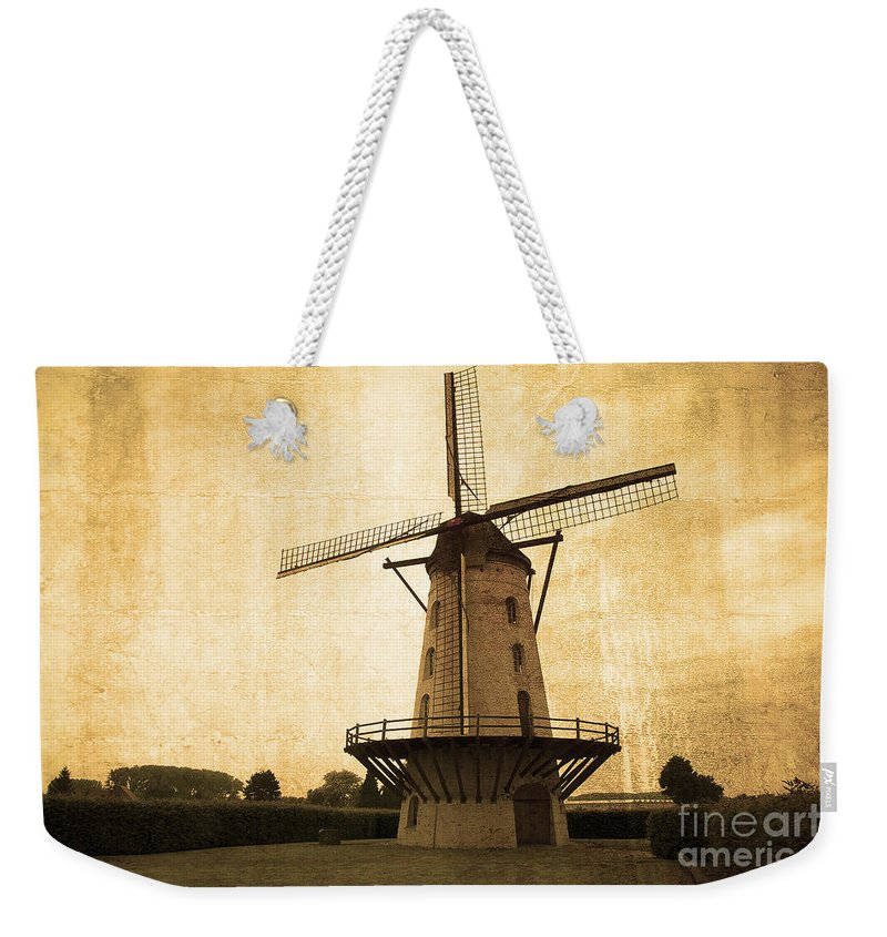 Windmill Weekender Tote Bag featuring the photograph Le Moulin Jaune by Rob Hawkins