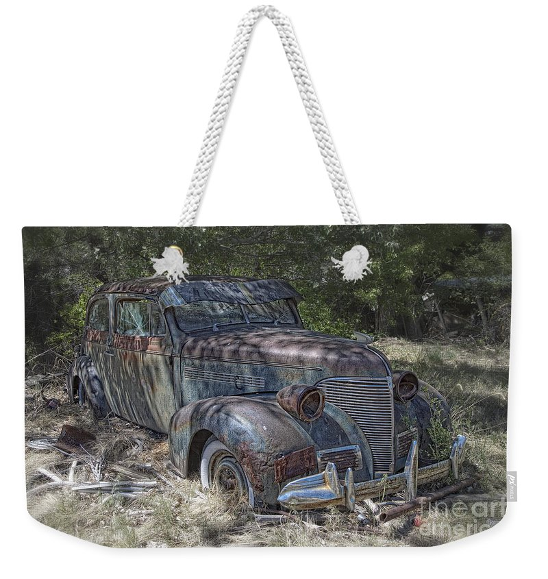 New Mexico Weekender Tote Bag featuring the photograph Left For Scrap by Timothy Hacker