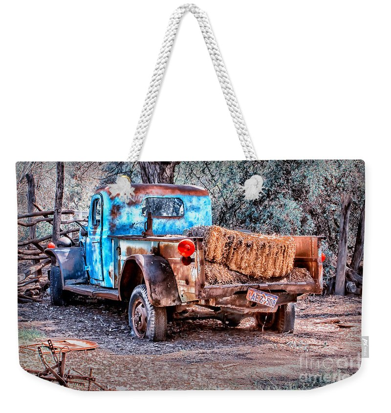 Truck Weekender Tote Bag featuring the digital art Left Over Hay by Georgianne Giese