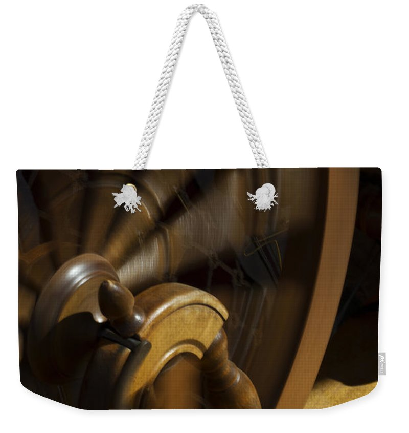 Spinning Wheel Weekender Tote Bag featuring the photograph Let The Spinning Wheel Spin by Guy Shultz