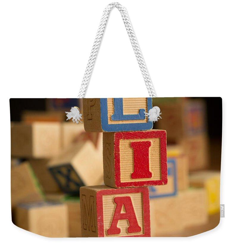 Alphabet Weekender Tote Bag featuring the photograph Liam - Alphabet Blocks by Edward Fielding