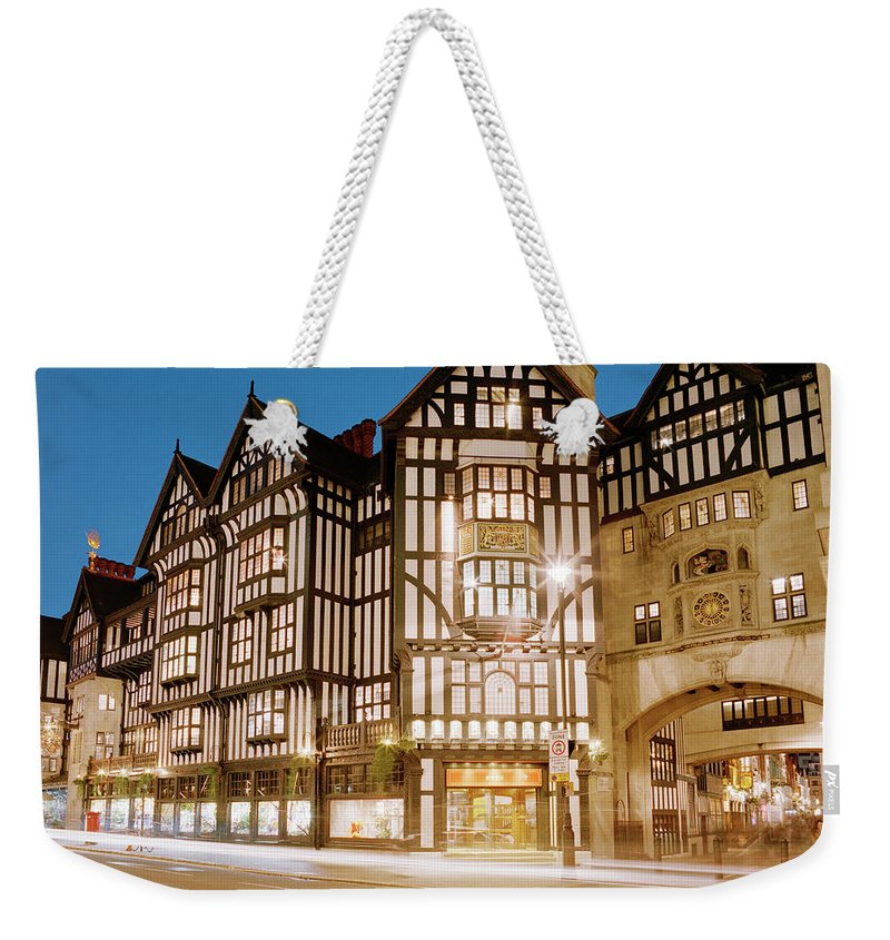 Old Town Weekender Tote Bag featuring the photograph Liberty Department Store At Dusk by Shomos Uddin