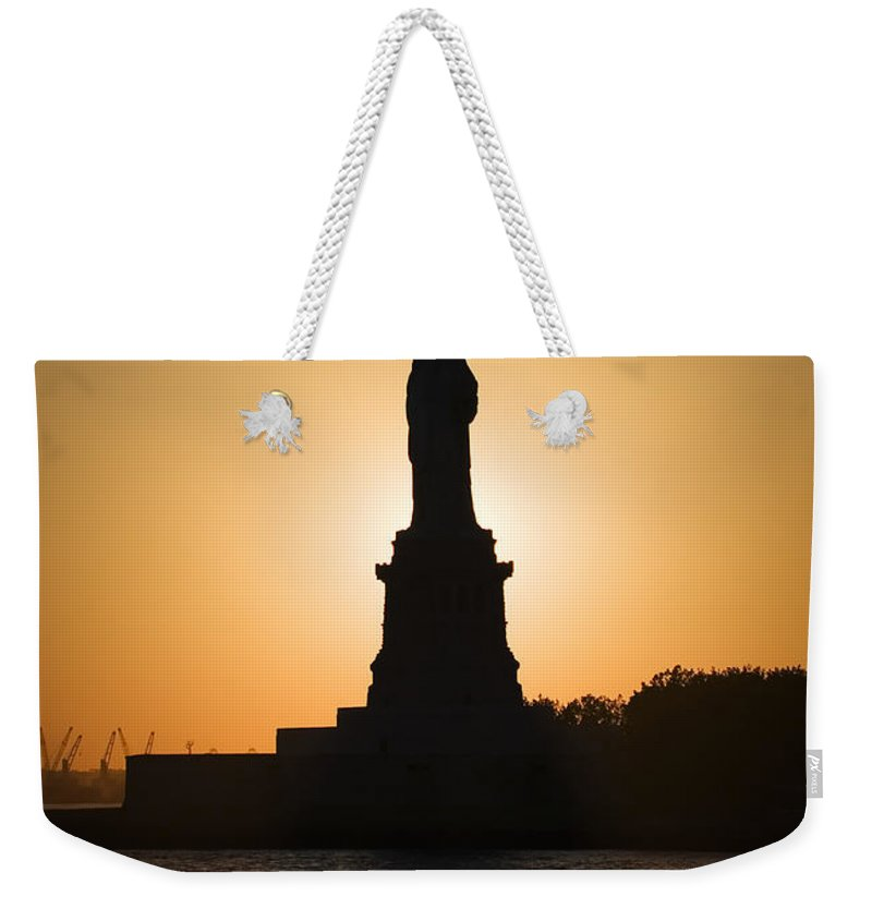 Statue Of Liberty Weekender Tote Bag featuring the photograph Liberty Sunset by Dave Bowman
