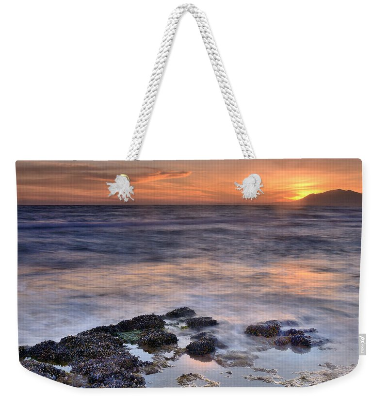 Seascape Weekender Tote Bag featuring the photograph Life On The Rocks by Guido Montanes Castillo