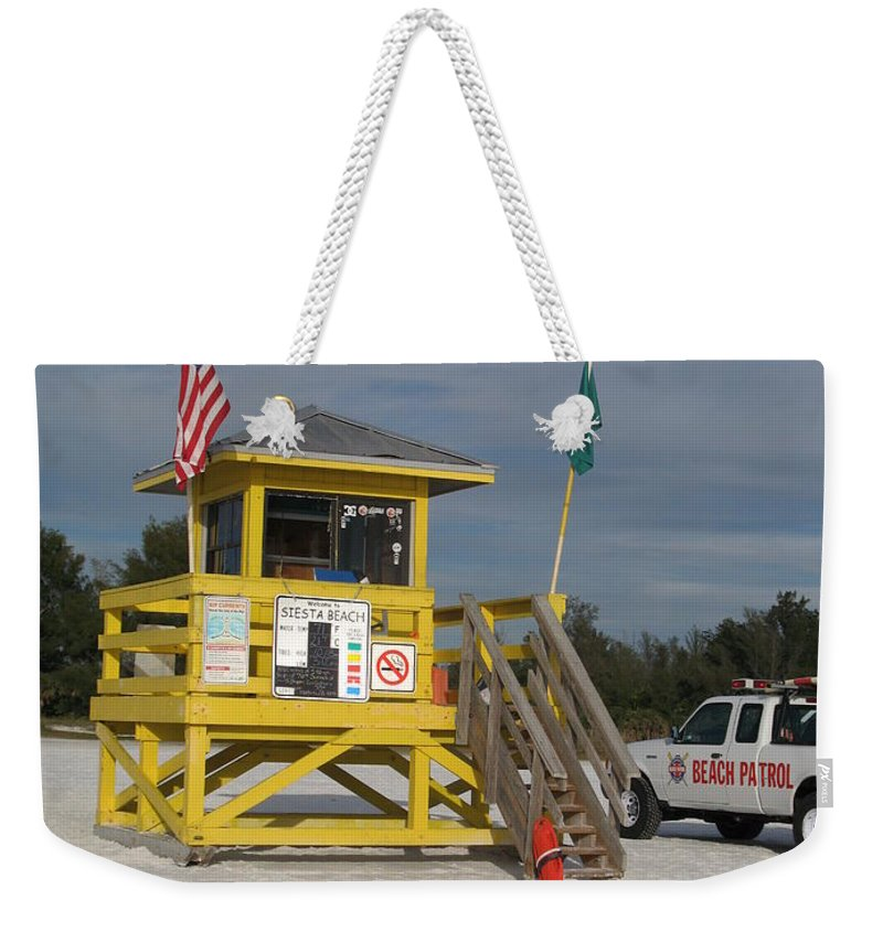 Beach Weekender Tote Bag featuring the photograph Lifeguard And Beachpatrol by Christiane Schulze Art And Photography