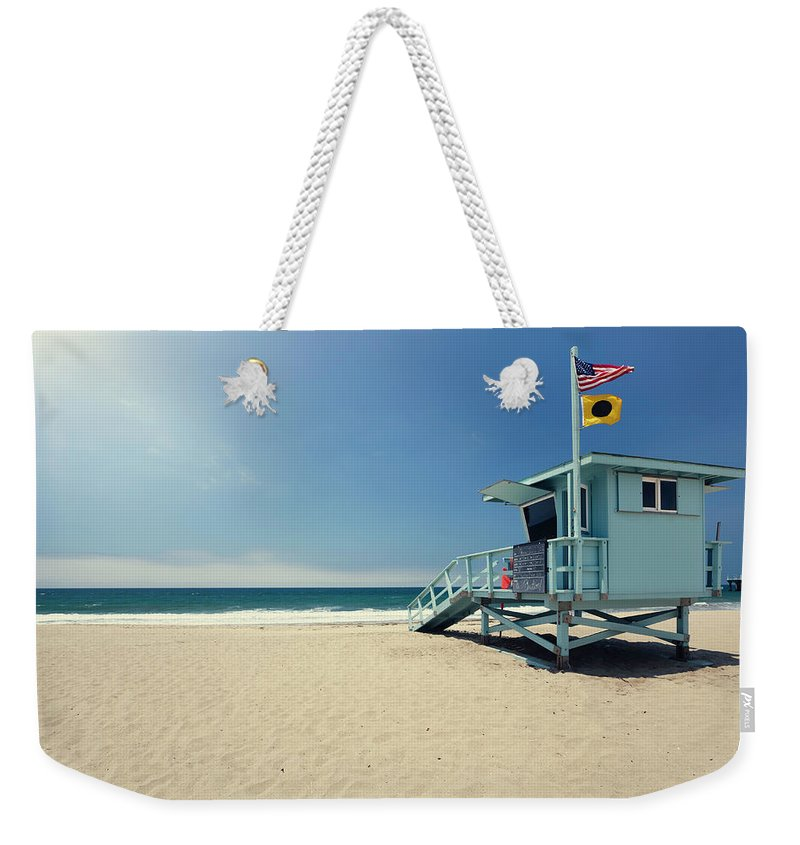 Water's Edge Weekender Tote Bag featuring the photograph Lifeguard Hut by Lordrunar