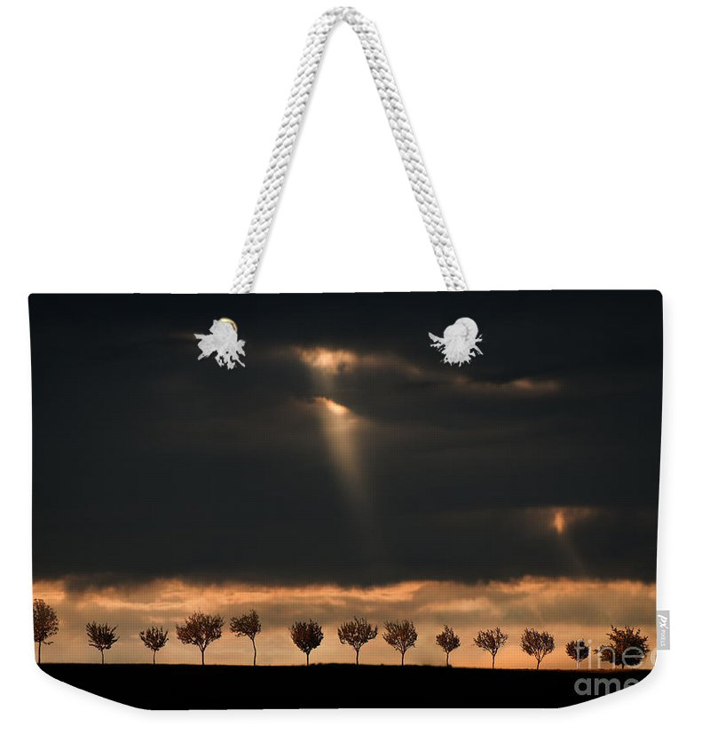Light Weekender Tote Bag featuring the photograph Light From The Sky by Jaroslaw Blaminsky