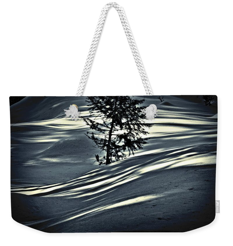 Sunlight Weekender Tote Bag featuring the photograph Light On The Snow by Janie Johnson
