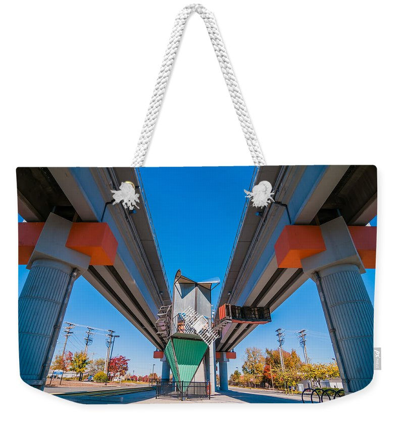 Architecture Weekender Tote Bag featuring the photograph Light Rail Train Station In  Charlotte Nc by Alex Grichenko