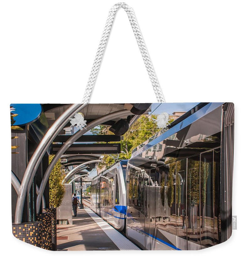 North Weekender Tote Bag featuring the photograph Light Rail Train System In Downtown Charlotte Nc by Alex Grichenko
