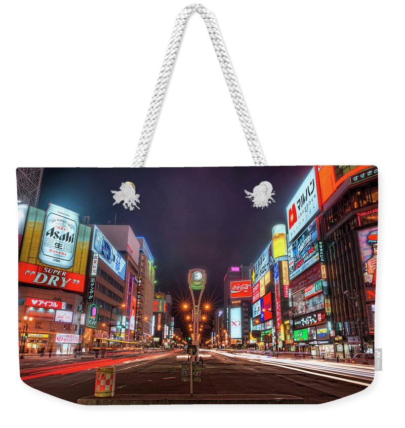 Hokkaido Weekender Tote Bag featuring the photograph Light Trails In Susukino by Daniel Chui