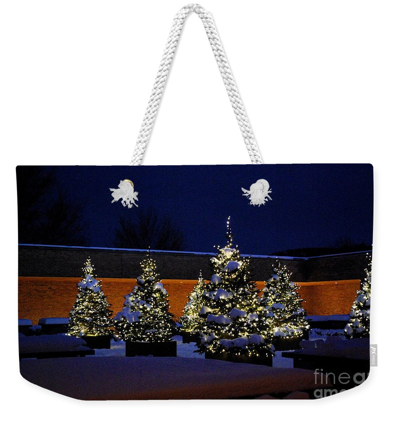Christmas Trees Weekender Tote Bag featuring the photograph Lighted Trees With Snow by Nancy Mueller