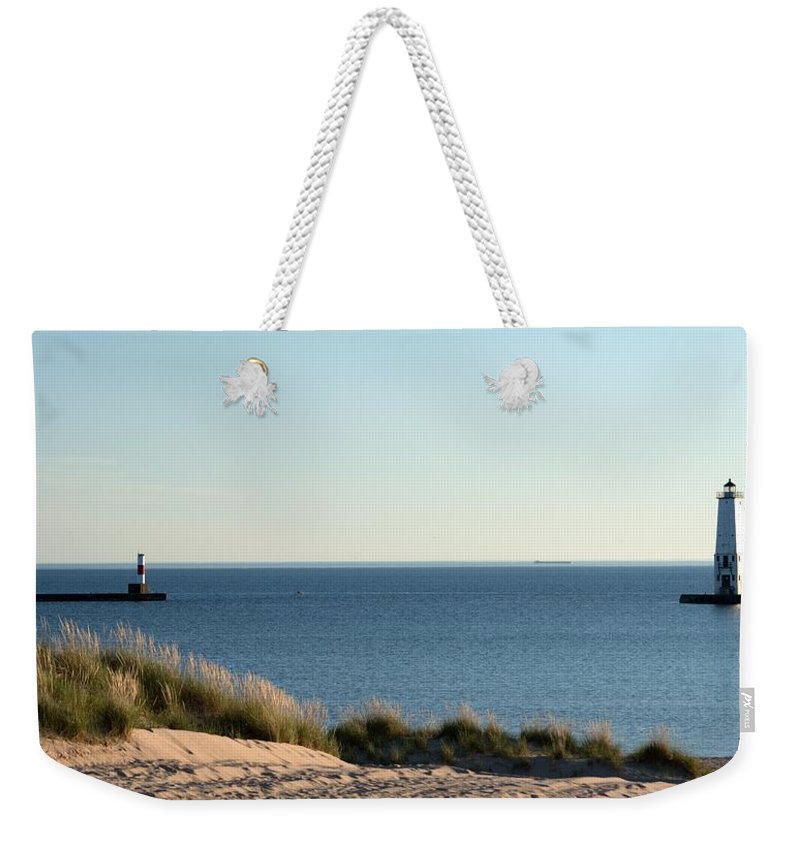 Michigan Weekender Tote Bag featuring the photograph Lighthouse And Pierhead by Linda Kerkau