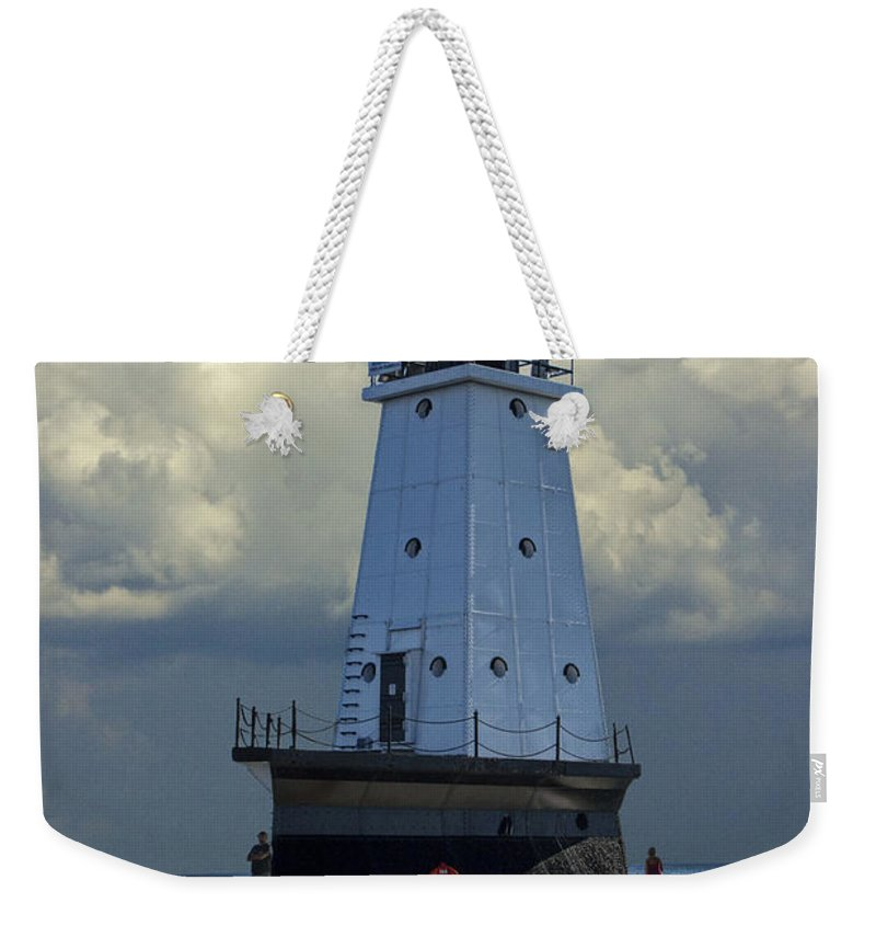 Art Weekender Tote Bag featuring the photograph Lighthouse At The End Of The Pier In Ludington Michigan by Randall Nyhof