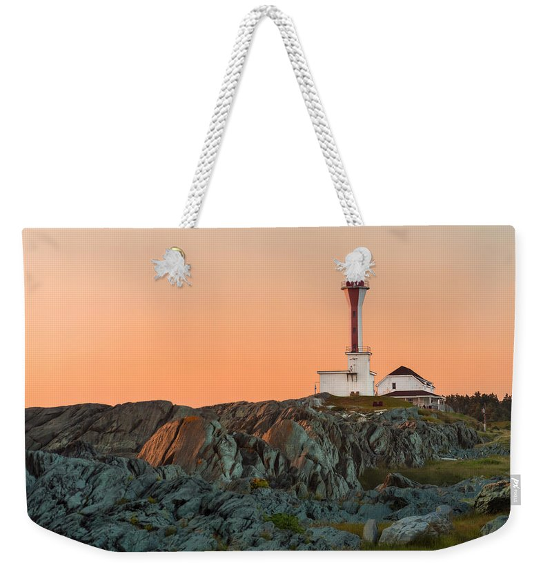 Lighthouse Weekender Tote Bag featuring the photograph Lighthouse Sunset by Garvin Hunter