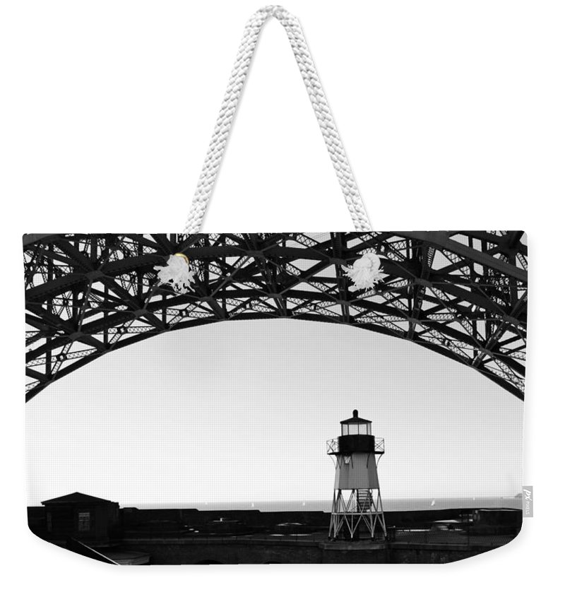 California Weekender Tote Bag featuring the photograph Lighthouse Under Golden Gate by Holly Blunkall