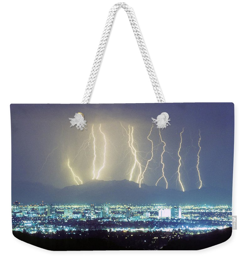 Lightning Weekender Tote Bag featuring the photograph Lightning Striking Over Phoenix Arizona by James BO Insogna