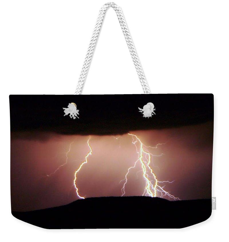 Lightning Weekender Tote Bag featuring the photograph Lightning Walking by Jeff Swan