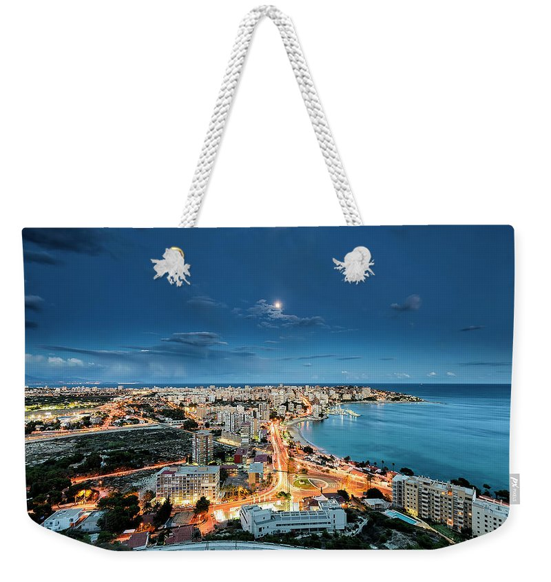 Built Structure Weekender Tote Bag featuring the photograph Lights In The City by Photographer Of The World