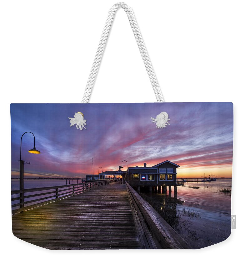 Clouds Weekender Tote Bag featuring the photograph Lights On The Dock by Debra and Dave Vanderlaan