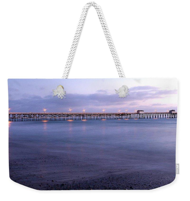 Lights On The Pier Weekender Tote Bag featuring the photograph Lights On The Pier by Richard Cheski