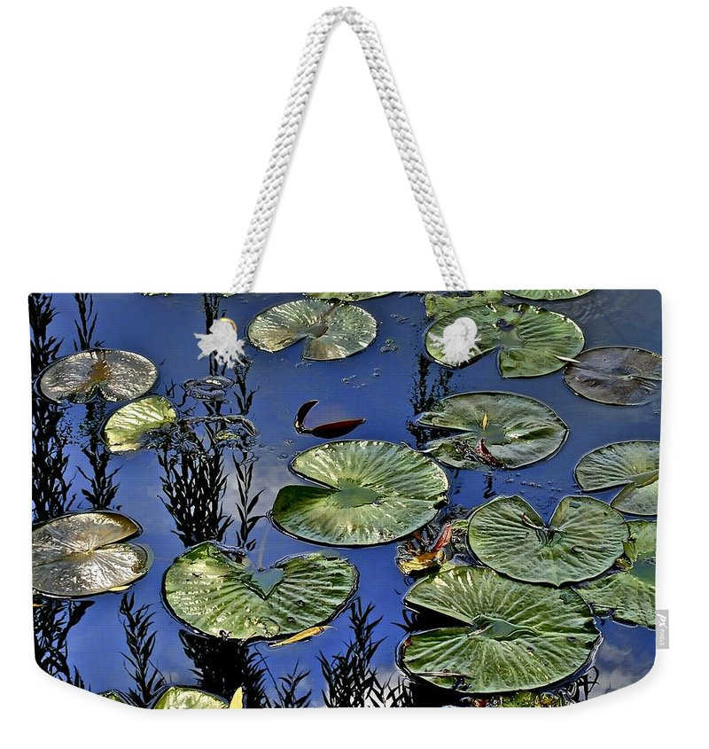 Lilly Weekender Tote Bag featuring the photograph Lilly Pond by Frozen in Time Fine Art Photography