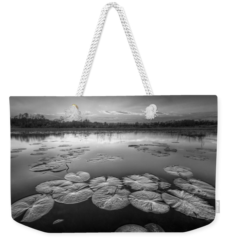 Clouds Weekender Tote Bag featuring the photograph Lily Pads in the Glades Black and White by Debra and Dave Vanderlaan