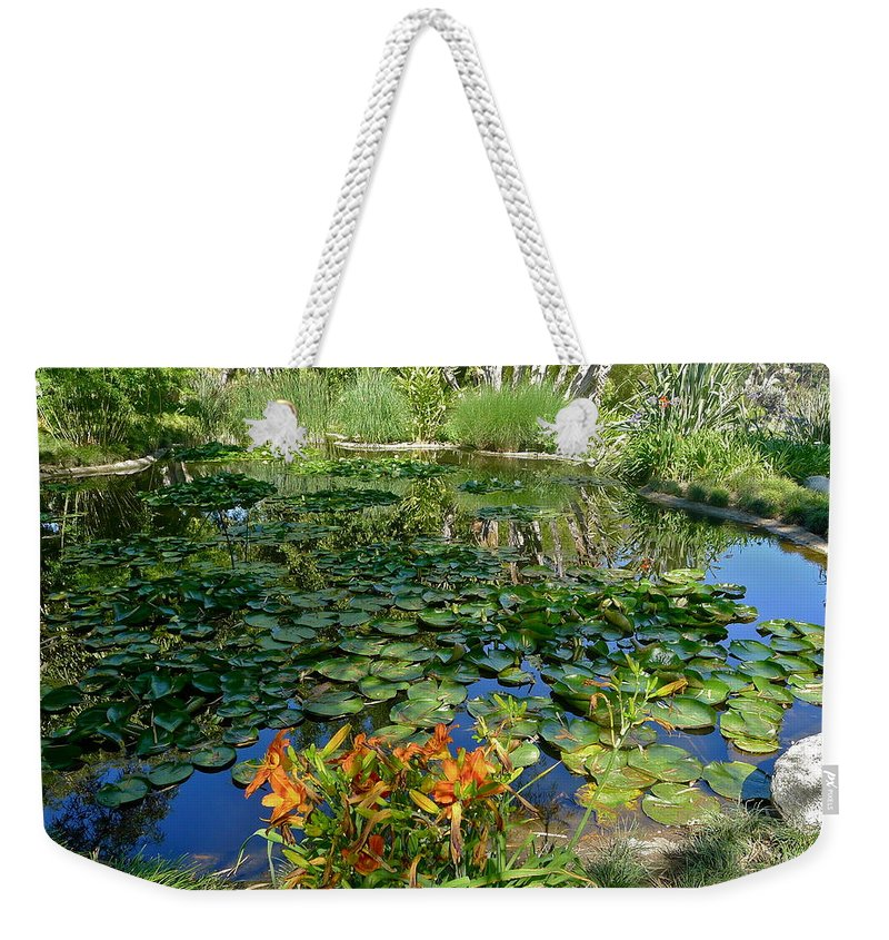 Lily Weekender Tote Bag featuring the photograph Lily Pond by Denise Mazzocco