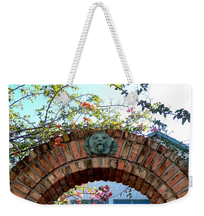 Lion Weekender Tote Bag featuring the photograph Lion Arch With Flowers by Katie Beougher
