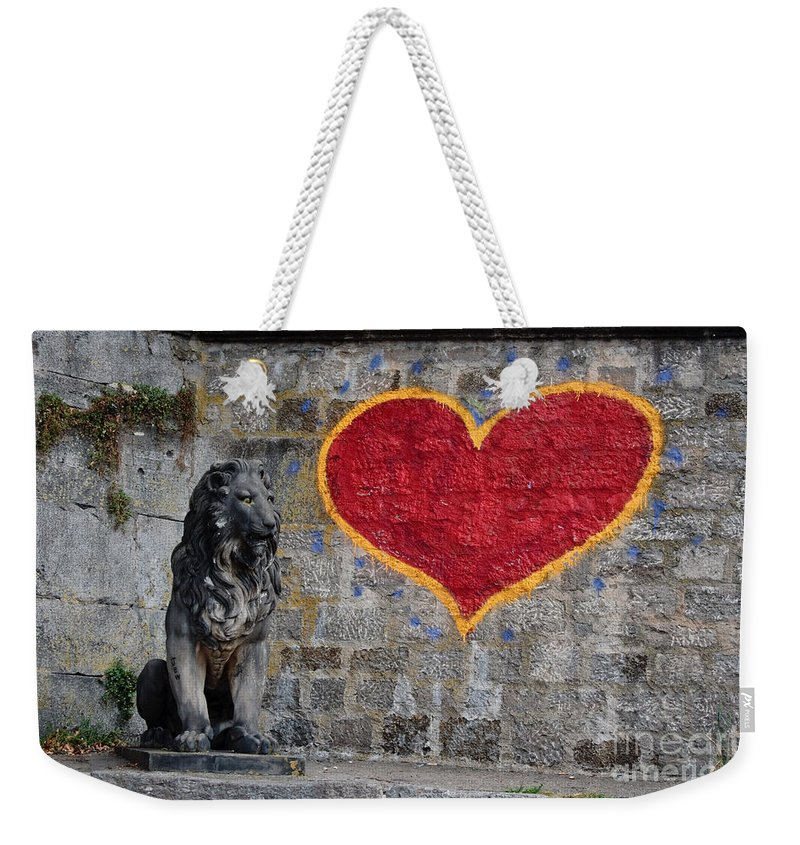 Statue Weekender Tote Bag featuring the photograph Lionheart by Thomas Marchessault