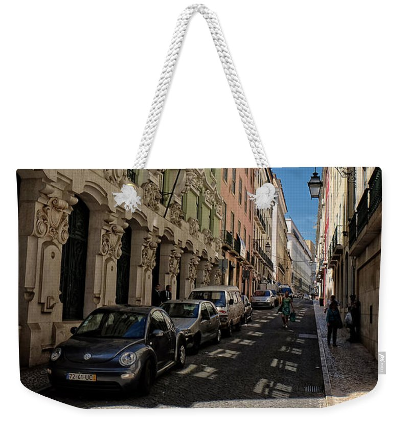 Lucinda Walter Weekender Tote Bag featuring the photograph Lisbon Street by Lucinda Walter