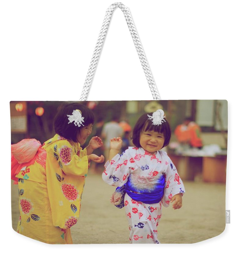 Tottori Prefecture Weekender Tote Bag featuring the photograph Little Girls At A Festival by Marvin Fox