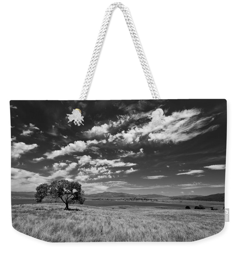 Big Sky Weekender Tote Bag featuring the photograph Little Prarie Big Sky - Black And White by Peter Tellone