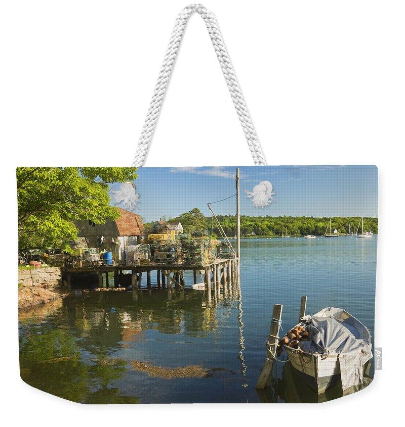 Maine Weekender Tote Bag featuring the photograph Lobster Traps On Pier In Round Pound On The Coast Of Maine by Keith Webber Jr