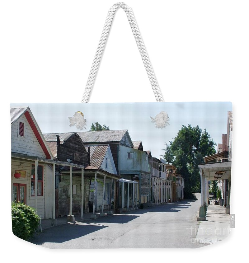 Landscapes Weekender Tote Bag featuring the photograph Locke Chinatown Series - Main Street - 1 by Mary Deal