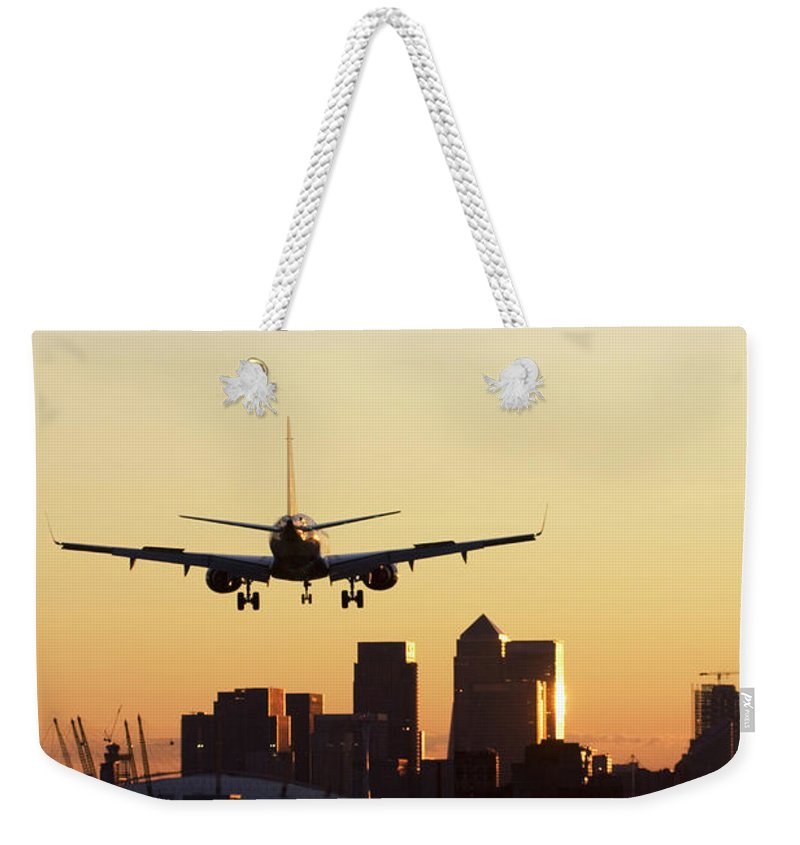 Taking Off Weekender Tote Bag featuring the photograph London City Airport by Greg Bajor