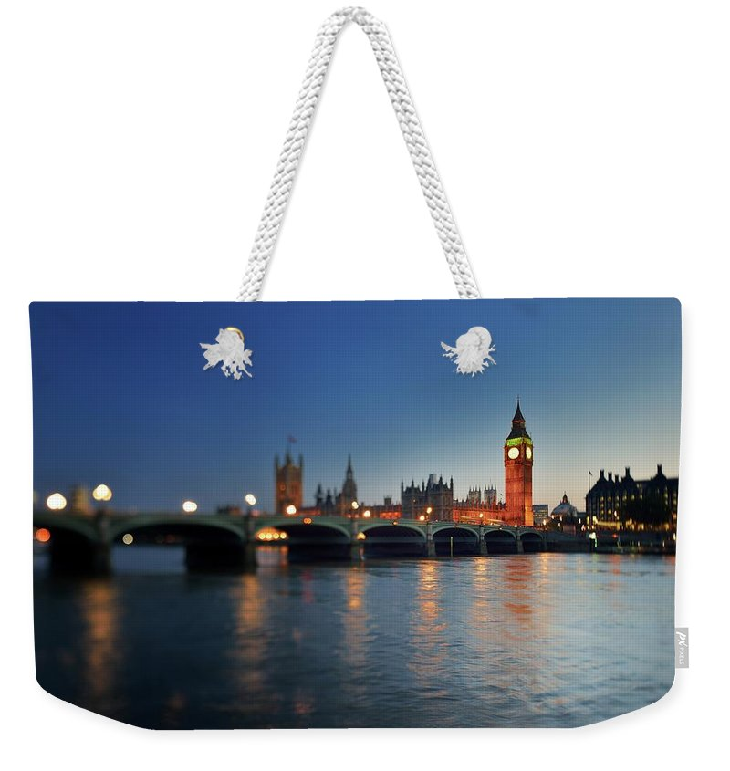 Tranquility Weekender Tote Bag featuring the photograph London, Palace Of Westminster At Sunset by Vladimir Zakharov