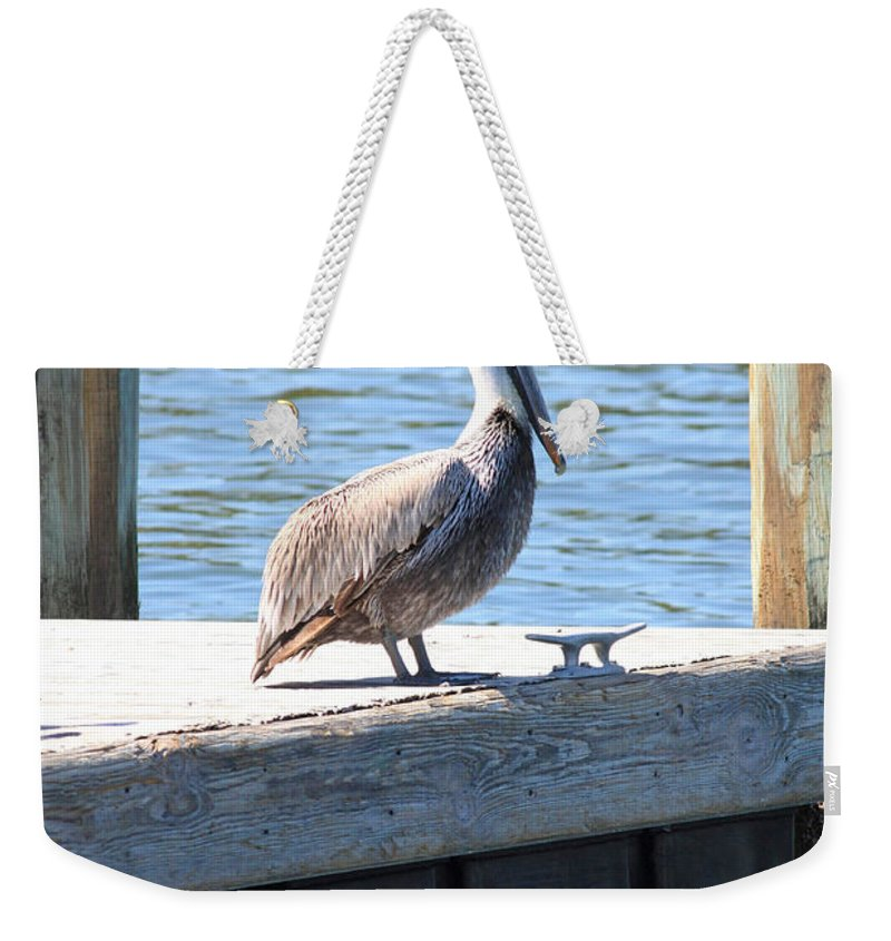 Pelican Weekender Tote Bag featuring the photograph Lone Pelican On Pier by Carol Groenen