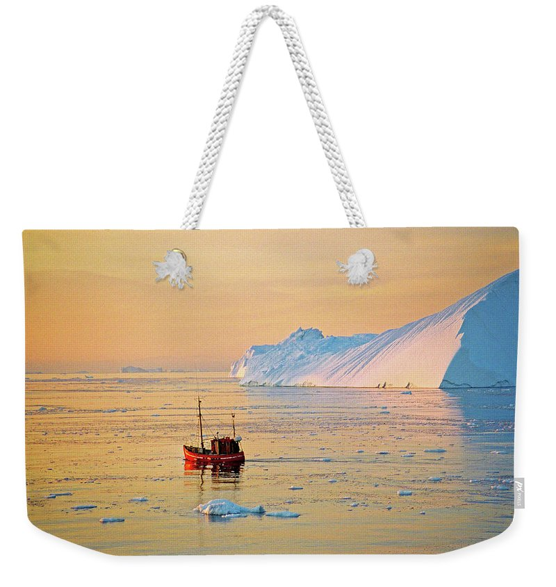 Greenland Weekender Tote Bag featuring the photograph Lonely Boat - Greenland by Juergen Weiss