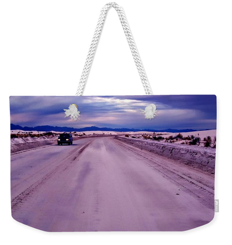 Road Weekender Tote Bag featuring the photograph Lonely Road by Bob Pardue