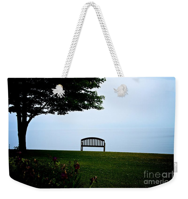 Sodus Weekender Tote Bag featuring the photograph Lonesome Bench by William Norton