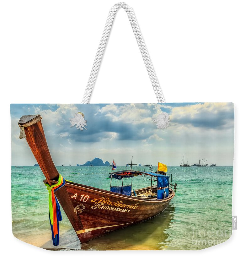 Asia Weekender Tote Bag featuring the photograph Longboat Asia by Adrian Evans