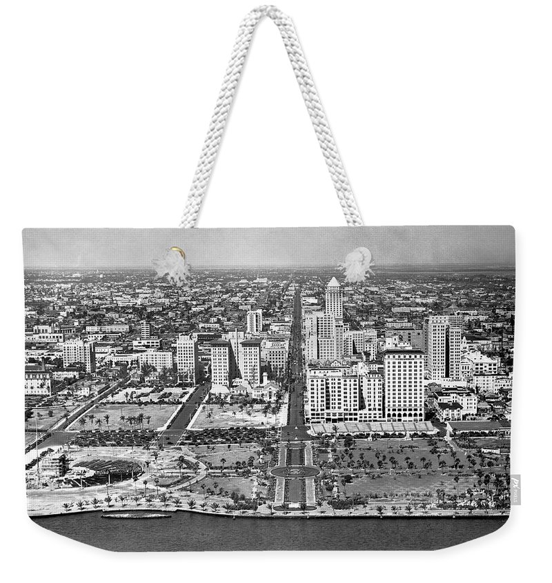 1920s Weekender Tote Bag featuring the photograph Looking Up Flagler Street At Downtown Miami by Underwood Archives