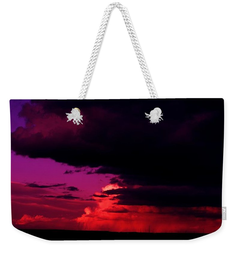 Clouds Weekender Tote Bag featuring the photograph Looming Clouds Over Alberta by Jeff Swan