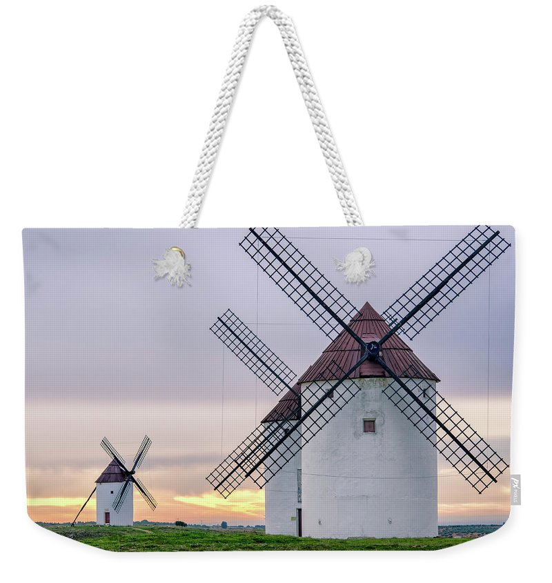 Environmental Conservation Weekender Tote Bag featuring the photograph Los Gigantes Del Quijote by Eddy Photo