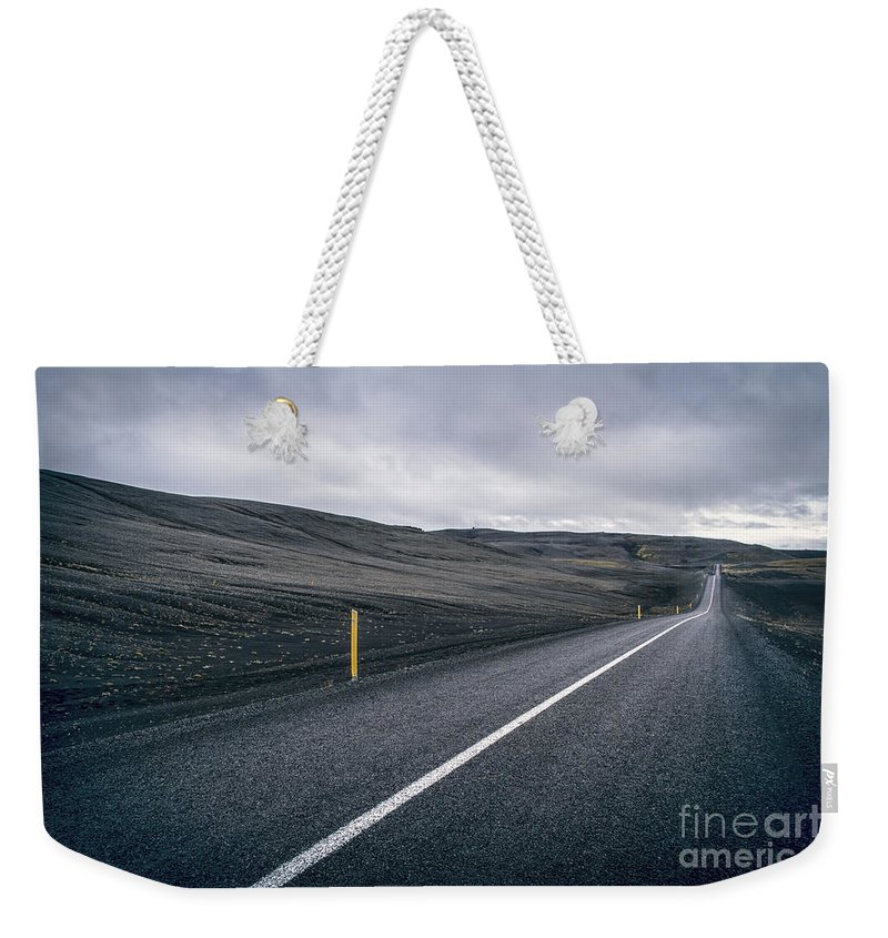 Landmannalaugar Weekender Tote Bag featuring the photograph Lost Highway by Evelina Kremsdorf